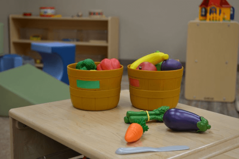 Fruit and vegetable toys in play area at ArKids Jonesboro