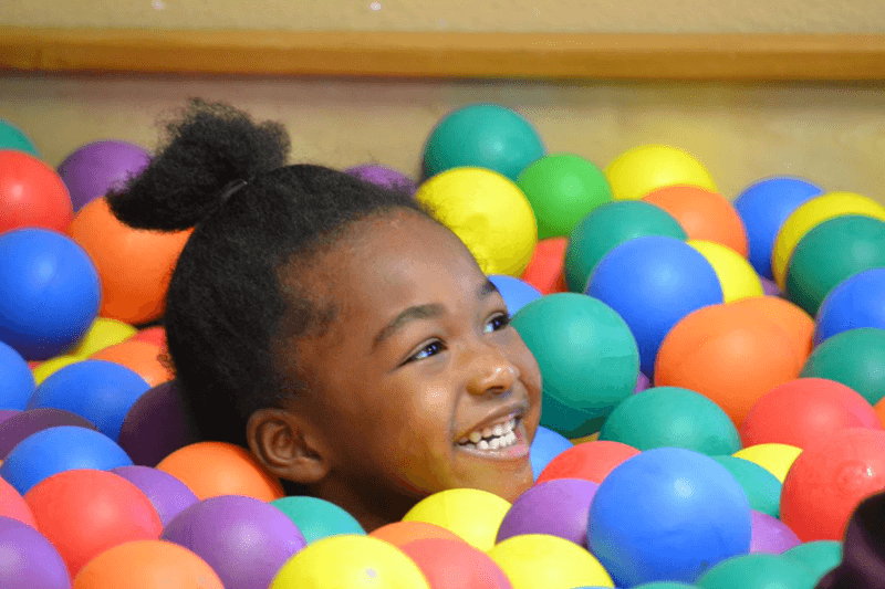 Child playing in ball pit at ArKids Paragould